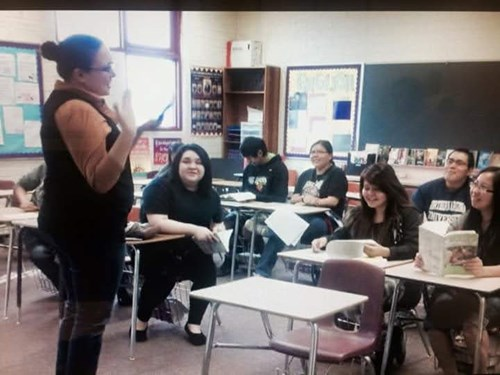An older photo provided by teacher Sarah Garcia shows her teaching an English class to smiling students at Ganado High School.
